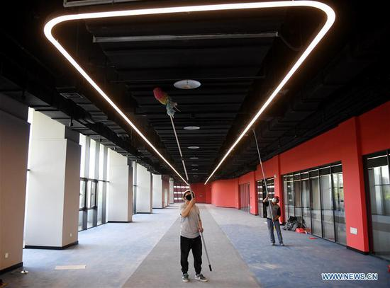 Workers clean the celling in the