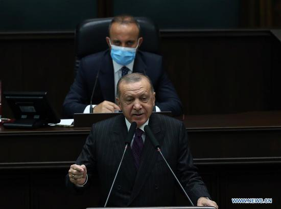 """Turkish President Recep Tayyip Erdogan (Front) addresses the parliament in Ankara, Turkey, on Oct. 14, 2020. Erdogan said Wednesday that he would announce the size of new gas reserves off the Black Sea this week while visiting the Turkish drilling ship """"Fatih"""". (Photo by Mustafa Kaya/Xinhua)"""