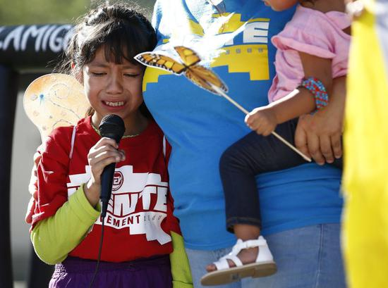 In this Monday, June 18, 2018 file photo, Akemi Vargas, 8, cries as she talks about being separated from her father during an immigration family separation protest in front of the Sandra Day O'Connor U.S. District Court building in Phoenix. Child welfare agencies across America make wrenching decisions every day to separate children from their parents. But those agencies have ways of minimizing the trauma that aren't being employed by the Trump administration at the Mexican border. (AP Photo/Ross D. Franklin)
