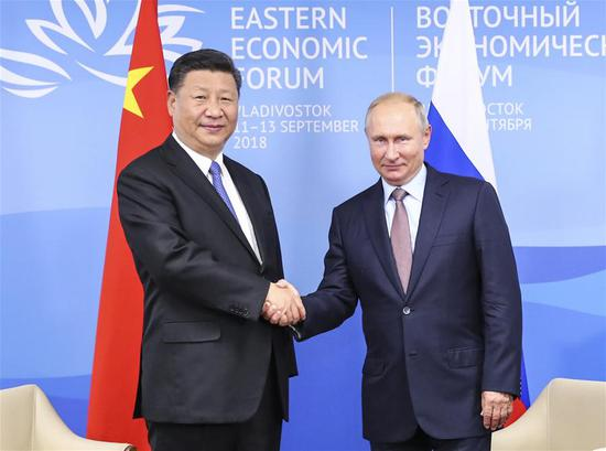 Chinese President Xi Jinping (L) holds talks with Russian President Vladimir Putin in Vladivostok, Russia, Sept. 11, 2018. (Xinhua/Xie Huanchi)