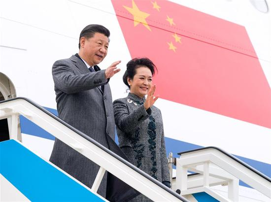 Chinese President Xi Jinping (L) and his wife Peng Liyuan disembark from the airplane after arriving in Lisbon, Portugal, on Dec. 4, 2018. Xi arrived in Portugal on Tuesday for a two-day state visit. (Xinhua/Li Xueren)