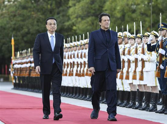 Chinese Premier Li Keqiang holds a welcome ceremony for visiting Pakistani Prime Minister Imran Khan before their talks in Beijing, capital of China, Oct. 8, 2019. Prime Minister Khan will attend the closing ceremony of the Beijing International Horticultural Exhibition. (Xinhua/Yin Bogu)