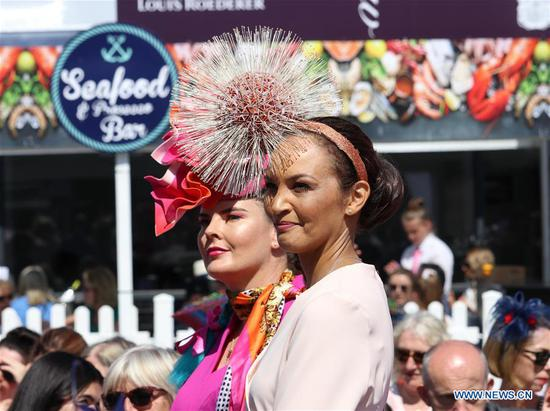 Two contestants are seen at Ladies' Day in Dublin, Ireland, Aug. 8, 2019. Ladies' Day is a fashion competition held annually during Dublin Horse Show in the Irish capital. (Xinhua)