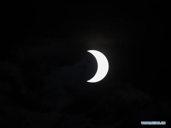 A partial solar eclipse is witnessed in Nairobi, capital of Kenya, June 21, 2020. (Xinhua/Xie Han)