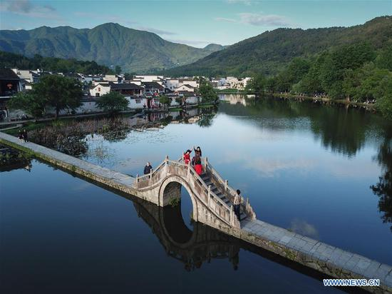 Aerial photo taken by drone shows scenery of Hongcun Village in Yixian County, east China's Anhui Province, May 8, 2018. (Xinhua/Xing Guangli)