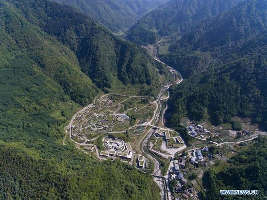 Aerial photo taken on May 16, 2018 shows the Shenshuping giant panda protection base of Wolong National Nature Reserve in Gengda Township, southwest China's Sichuan Province. The Wolong reserve, some 30 kilometers away from the epicenter of the devastating 2008 earthquake, was severely damaged in the disaster. As a result, some pandas inhabiting the reserve had to be relocated in zoos after the quake. As years passed, Wolong still remains as a suitable habitat for giant panda. Sponsored by the government of the Hong Kong Special Administrative Region, the Shenshuping base covering an area of about 150 hectares opened on May 11, 2016. It is now home to more than 50 giant pandas. (Xinhua/Jiang Hongjing)
