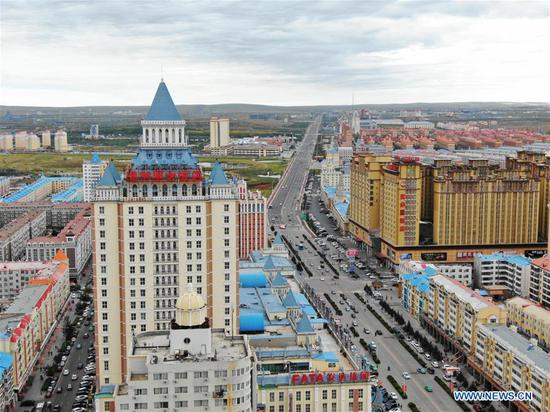 Photo taken with drone on Sept. 8, 2018 shows a part of Manzhouli city of north China's Inner Mongolia Autonomous Region. Manzhouli, a border city with Russia, is benefiting from import and export trade between the two countries and witnessed a rapid economic and social development since China opened up to the world 40 years ago. (Xinhua/Zou Yu)
