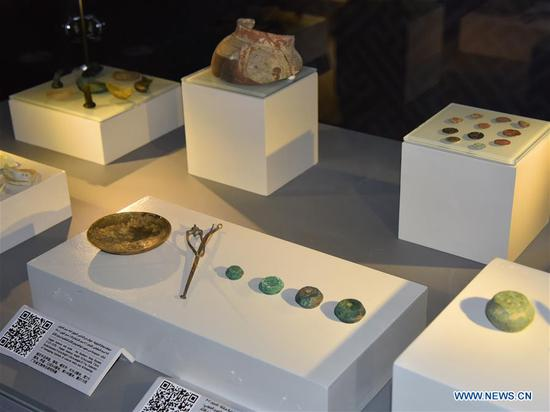 "Objects from Chinese-Saudi joint archaeological excavations at the ruins of al Sereen site are displayed at the exhibition ""Treasures of China"" in Riyadh, Saudi Arabia, on Sept. 12, 2018. An exhibition featuring Chinese civilization opened on Wednesday at the National Museum in Saudi Arabia's capital Riyadh. (Xinhua/Tu Yifan)"