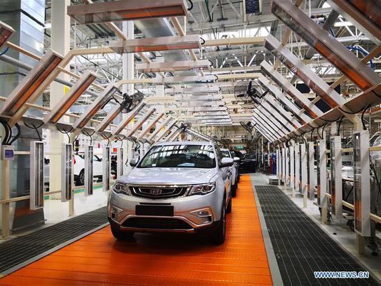 Photo taken on Dec. 1, 2018 shows vehicles at the assembly plant of the Chinese-Belarusian joint venture BelGee in Belarus. (Xinhua/Zhang Ruoxuan)