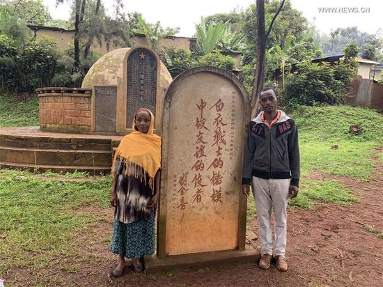 Zewdie Haile (L) and Sisay Haile pose for a photo in front of the tomb of Chinese docotr Mei Gengnian in Jimma, Ethiopia, Aug. 5, 2019. Since 1963, some 220 million patients in 48 African countries have been treated by Chinese medical personnel as of 2018, according to the National Health Commission. Currently, 983 Chinese doctors are providing free medical services in 45 African countries. (Xinhua/Wang Shoubao)
