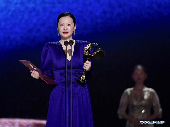 Yong Mei is honored with the Best Actress Award for the movie