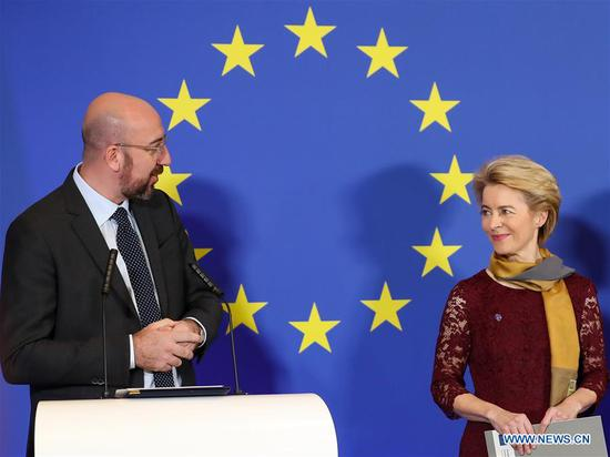 European Council President Charles Michel (L) and European Commission President Ursula von der Leyen attend a ceremony to mark the 10th anniversary of the entry into force of the Lisbon Treaty, at the House of European History in Brussels, Belgium, Dec. 1, 2019. (Xinhua/Zhang Cheng)