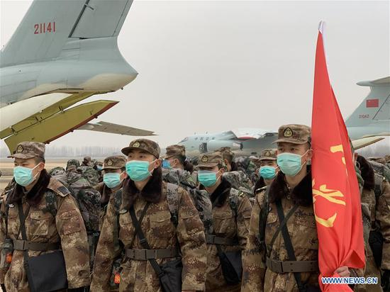 Military medical staff airlifted by eight large transport planes of the air force of the People's Liberation Army (PLA) arrive at Tianhe International Airport in Wuhan, central China's Hubei Province, Feb. 2, 2020. (Xinhua/Li Yun)