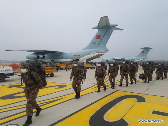 Military medical staff sitting in large transport plane of the air force of the People's Liberation Army (PLA) are on their way to Wuhan, central China's Hubei Province, Feb. 2, 2020. (Photo by Yuan Zhilong/Xinhua)