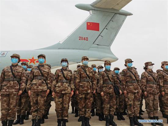 Military medical staff airlifted by eight large transport planes of the air force of the People's Liberation Army (PLA) arrive at Tianhe International Airport in Wuhan, central China's Hubei Province, Feb. 2, 2020. (Photo by Li Shining/Xinhua)