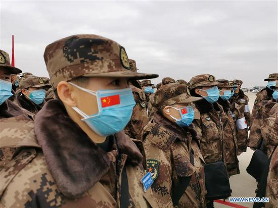 Military medics arrive at Tianhe International Airport in Wuhan, central China's Hubei Province, Feb. 13, 2020. Ordered by the Central Military Commission, 11 transport aircraft of the People's Liberation Army Air Force Thursday sent medics and supplies provided by the armed forces to virus-hit Wuhan, capital of Hubei Province. This was the first time for China's domestically developed large transport aircraft Y-20 to take part in non-military action. It was also the first time for the Air Force to send large and medium transport aircraft on active service to carry out urgent air transport tasks on a large scale. (Xinhua/Li Yun)