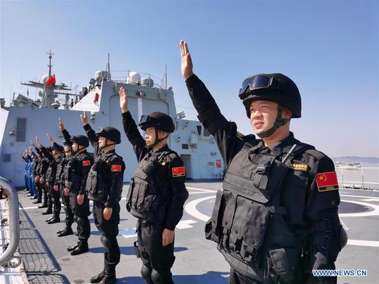 Special operation soldiers of the Chinese naval fleet for escort mission wave farewell on the deck at a port in Zhoushan, east China's Zhejiang Province, April 28, 2020. The 35th fleet of the Chinese People's Liberation Army (PLA) Navy on Tuesday left the port city of Zhoushan in east China's Zhejiang Province for the Gulf of Aden and waters off Somalia to escort civilian ships. Composed of the guided-missile destroyer Taiyuan, the missile frigate Jingzhou and the supply ship Chaohu, the fleet has more than 690 officers and soldiers, dozens of special operation soldiers and two helicopters on board. (Photo by Jiang Shan/Xinhua)