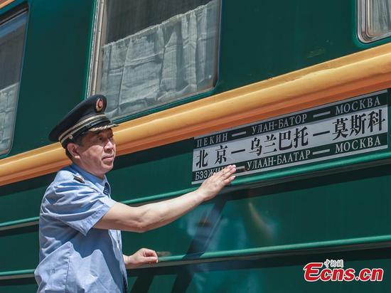 Sun Guoxiang, a conductor who is the same age as the K3/4 train, checks on the train in Beijing on May 19, 2020. (Photo: China News Service/Jia Tianyong)