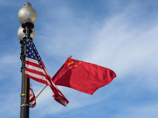 File photo shows the national flags of China (R) and the United States on the Constitution Avenue in Washington, capital of the United States. (Xinhua/Bao Dandan)