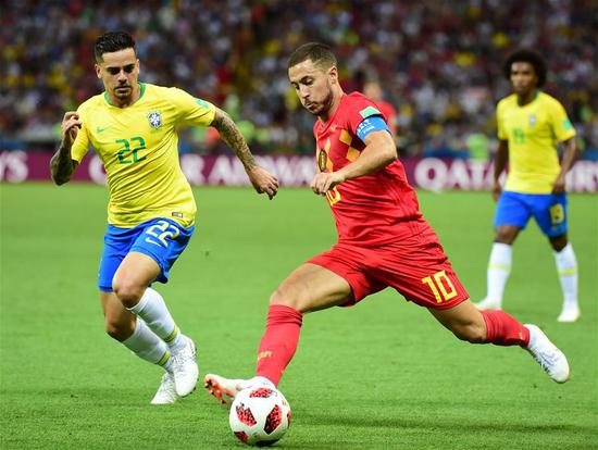 Fagner (L) of Brazil vies with Eden Hazard of Belgium during the 2018 FIFA World Cup quarter-final match between Brazil and Belgium in Kazan, Russia, July 6, 2018. (Xinhua/Du Yu)