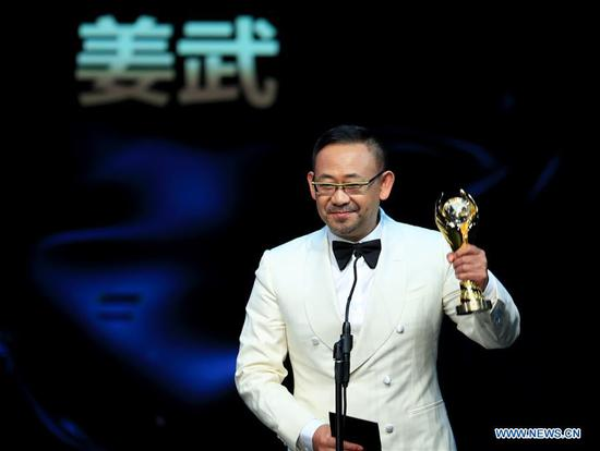 Actor Jiang Wu who won the award of Best Actor in a Supporting Role, receives the trophy during the awarding ceremony of the 14th Chinese American Film Festival (CAFF) in Los Angeles, the United States, Oct. 30, 2018. The 14th Chinese American Film Festival (CAFF) kicked off Tuesday at the Ricardo Montalban Theater in Hollywood in the U.S. city of Los Angeles. (Xinhua/Li Ying)