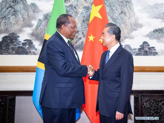 Chinese State Councilor and Foreign Minister Wang Yi (R) meets with Tanzania's Foreign Minister Palamagamba Kabudi in Beijing, capital of China, June 24, 2019. Palamagamba Kabudi was here to attend the Coordinators' Meeting on the Implementation of the Follow-up Actions of the Beijing Summit of the Forum on the China-Africa Cooperation (FOCAC). (Xinhua/Zhai Jianlan)