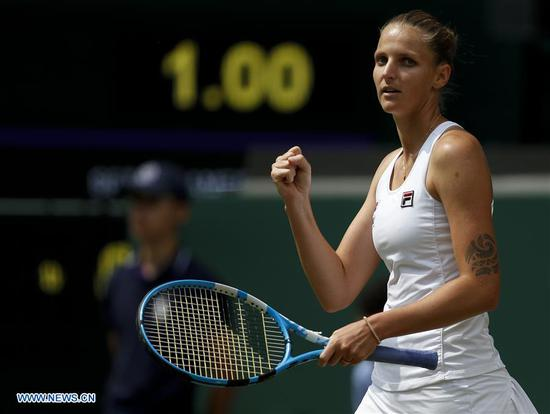 Karolina Pliskova of Czech Republic celebrates after the women's singles second round match with Monica Puig of Puerto Rico at the 2019 Wimbledon Tennis Championships in London, Britain, on July 3, 2019. (Xinhua/Han Yan)