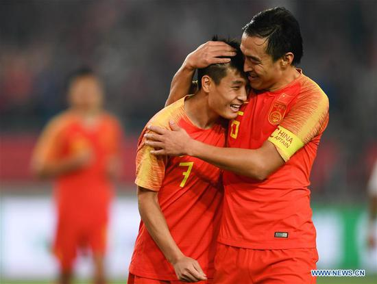 Wu Lei (L) of China celebrates after scoring with his teammate Feng Xiaoting during the CFA Team China International Football Match 2018 between China and Syria in Nanjing, capital of east China's Jiangsu Province, Oct. 16, 2018. China won 2-0. (Xinhua/Ji Chunpeng)