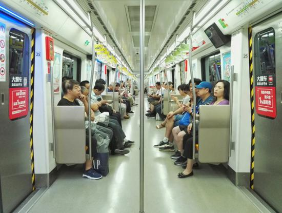 Passengers take a subway train on the Metro Line 6 in Beijing, June 29, 2018. [File photo: IC]