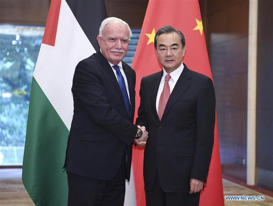 Chinese State Councilor and Foreign Minister Wang Yi (R) holds talks with Palestinian Foreign Minister Riyad al-Malki in Beijing, capital of China, July 11, 2018. Al-Malki was here to attend the eighth ministerial conference of the China-Arab States Cooperation Forum held Tuesday. (Xinhua/Yan Yan)