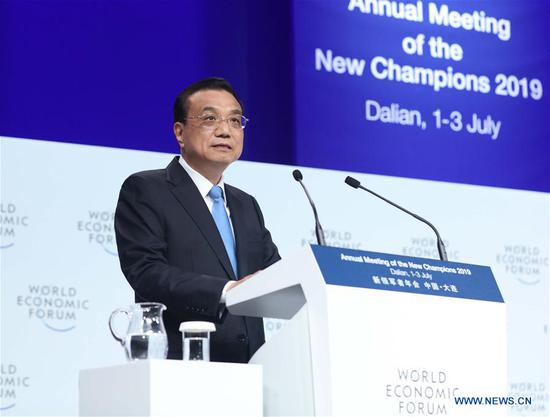 Chinese Premier Li Keqiang addresses the opening ceremony of the Annual Meeting of the New Champions 2019, also known as the Summer Davos Forum, in the city of Dalian, northeast China's Liaoning Province, July 2, 2019. (Xinhua/Liu Weibing)