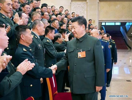 习近平要求全面推进基层军事发展