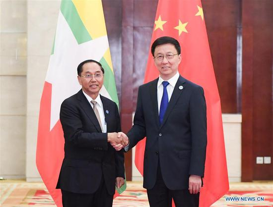 Chinese Vice Premier Han Zheng, also a member of the Standing Committee of the Political Bureau of the Communist Party of China Central Committee, meets with Myanmar's Vice President U Myint Swe who is here to attend the 16th China-Association of Southeast Asian Nations (ASEAN) Expo and the China-ASEAN Business and Investment Summit in Nanning, capital of south China's Guangxi Zhuang Autonomous Region, Sept. 20, 2019. (Xinhua/Shen Hong)