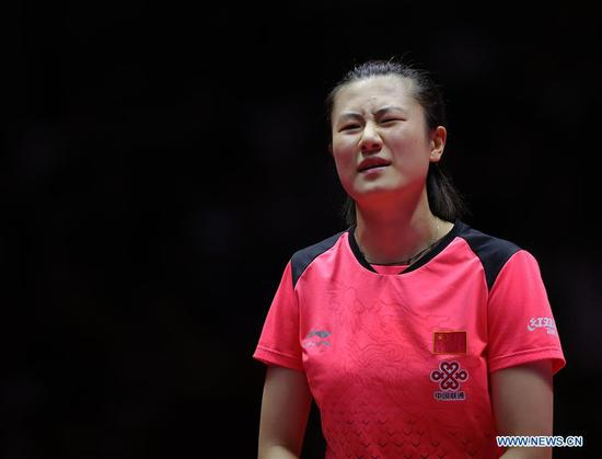 Ding Ning of China reacts during the women's singles final match against Wang Manyu of China at the 2018 ITTF World tour China Open in Shenzhen, south China's Guangdong Province, on June 3, 2018. Wang Manyu claimed the title by defeating Ding Ning with 4-3 in the final. (Xinhua/Wang Dongzhen)