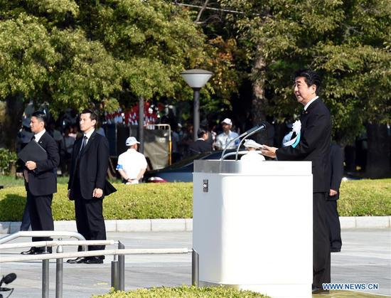 Japanese Prime Minister Shinzo Abe (Front) speaks during a ceremony commemorating the 73rd anniversary of the atomic bombing of Hiroshima at the Peace Memorial Park in Hiroshima, Japan on Aug. 6, 2018. (Xinhua/Ma Ping)