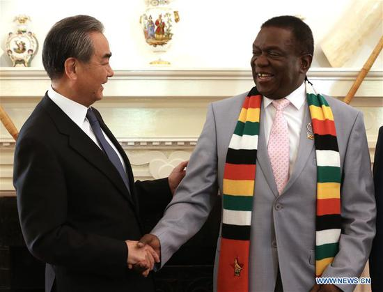 Zimbabwean President Emmerson Mnangagwa (R) meets with Chinese State Councilor and Foreign Minister Wang Yi in Harare, Zimbabwe, Jan. 13, 2020. (Photo by Chen Yaqin/Xinhua)
