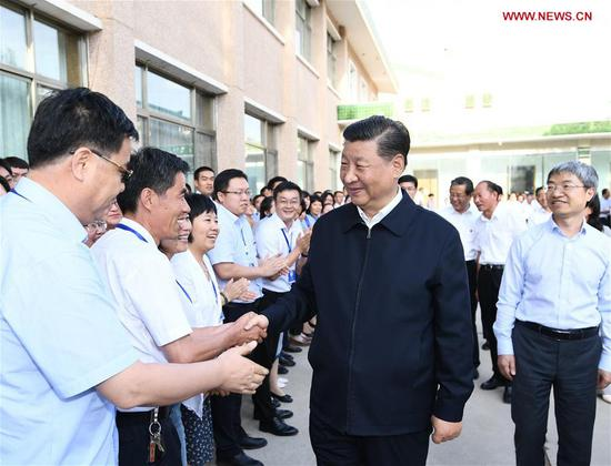 Chinese President Xi Jinping, also general secretary of the Communist Party of China (CPC) Central Committee and chairman of the Central Military Commission, visited exhibitions of relics and research results and attended a symposium with experts, scholars and representatives from cultural units in the Dunhuang Academy in Dunhuang during his inspection tour of northwest China's Gansu Province, Aug. 19, 2019. (Xinhua/Xie Huanchi)