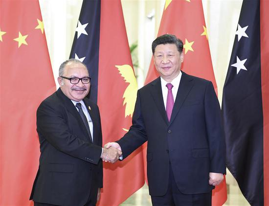 Chinese President Xi Jinping (R) meets with Papua New Guinea (PNG) Prime Minister Peter O'Neill, who is here to attend the Second Belt and Road Forum for International Cooperation, in Beijing, capital of China, April 25, 2019. (Xinhua/Yan Yan)