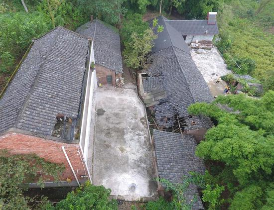 Aerial photo taken on Sept. 8, 2019 shows damaged building at a village in Longhui Town of Weiyuan County, Neijiang City, southwest China's Sichuan Province. The 5.4-magnitude earthquake in Sichuan Province had killed one person and left 63 others injured, three severely, as of 6 p.m. Sunday, local authorities said. (Xinhua/Liu Kun)