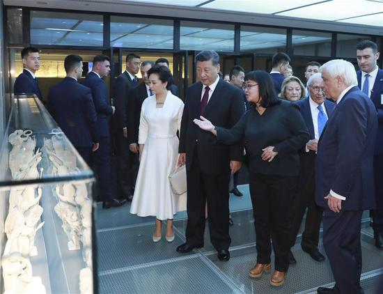 Chinese President Xi Jinping and his wife Peng Liyuan visit the Acropolis Museum accompanied by Greek President Prokopis Pavlopoulos and his wife Vlassia Pavlopoulou-Peltsemi in Athens, Greece, Nov. 12, 2019. (Xinhua/Ding Lin)