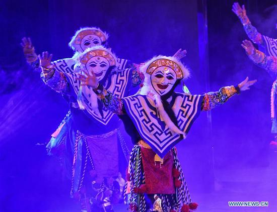 Dancers perform a traditional opera on stage in Aba County of Aba Tibetan and Qiang Autonomous Prefecture, southwest China's Sichuan Province, June 14, 2020. Located in northwest of Sichuan Province, with nearly one million population, Aba Tibetan and Qiang Autonomous Prefecture has a diversity of ethnic minority groups, including Tibetan, Qiang and Hui, etc. In recent years, to better inherit the ethnic culture, local schools have introduced more traditional cultural courses while local authorities set up training workshops about intangible cultural heritage to help local villagers learn traditional crafts, as a way to boost their incomes. In 2018, the production value of cultural industry in this prefecture has reached about 1.2 billion yuan (about 169.8 million U.S. dollars), accounting for 3.32 percent of gross domestic product (GDP) of this prefecture. (Xinhua/Liu Kun)