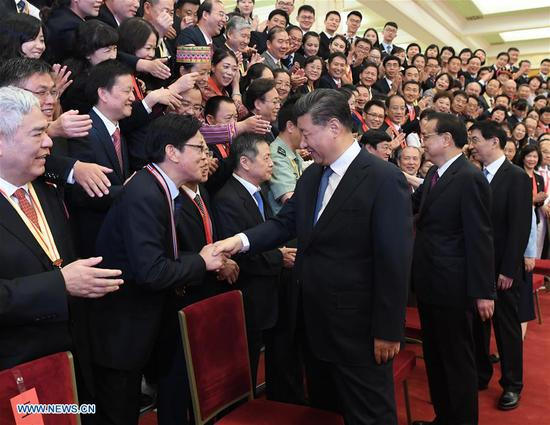 Chinese President Xi Jinping, also general secretary of the Communist Party of China (CPC) Central Committee and chairman of the Central Military Commission, meets with representatives of outstanding units and individuals in education circles at the Great Hall of the People in Beijing, capital of China, Sept. 10, 2019, extending Teachers' Day greetings to teachers and workers in education circles across the country. Also present were Premier Li Keqiang and Wang Huning, a member of the Secretariat of the CPC Central Committee, both of whom are members of the Standing Committee of the Political Bureau of the CPC Central Committee. (Xinhua/Shen Hong)