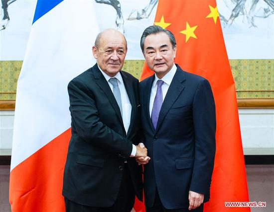 Chinese State Councilor and Foreign Minister Wang Yi (R) holds talks with French Foreign Minister Jean-Yves Le Drian in Beijing, capital of China, Sept. 13, 2018. (Xinhua/Liu Bin)