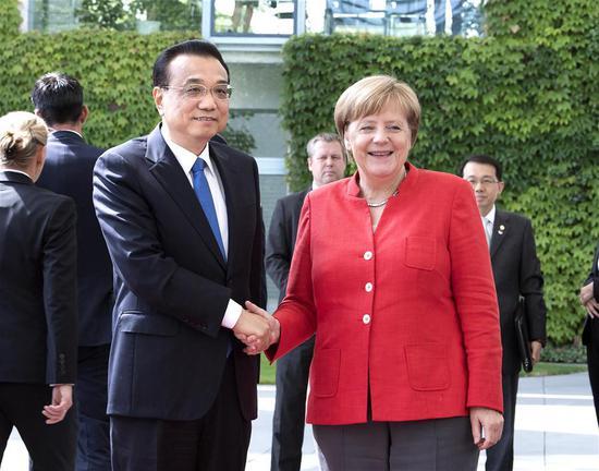 Chinese Premier Li Keqiang holds talks with German Chancellor Angela Merkel in Berlin, Germany, July 9, 2018. (Xinhua/Liu Weibing)