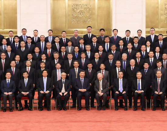 Chinese President Xi Jinping, also general secretary of the Communist Party of China (CPC) Central Committee and chairman of the Central Military Commission, meets with representatives of space scientists and engineers who participated in the research and development of the Chang'e-5 lunar mission in Beijing, capital of China, Feb. 22, 2021. Xi Jinping met representatives of space scientists and engineers who participated in the research and development of the Chang'e-5 lunar mission at the Great Hall of the People in Beijing on Monday. Xi also visited an exhibition on the lunar samples brought back by the Chang'e-5 probe and China's lunar exploration achievements as well. Li Keqiang, Li Zhanshu, Wang Yang, Wang Huning, Zhao Leji, and Han Zheng, all members of the Standing Committee of the Political Bureau of the CPC Central Committee, also attended the event. (Xinhua/Wang Ye)