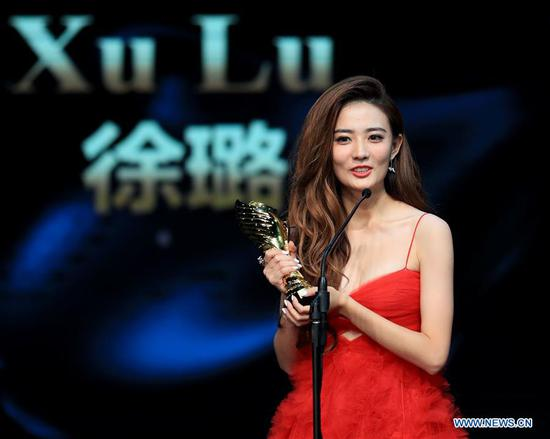 Actress Xu Lu who won the Best New Actress Award, receives the trophy during the awarding ceremony of the 14th Chinese American Film Festival (CAFF) in Los Angeles, the United States, Oct. 30, 2018. The 14th Chinese American Film Festival (CAFF) kicked off Tuesday at the Ricardo Montalban Theater in Hollywood in the U.S. city of Los Angeles. (Xinhua/Li Ying)