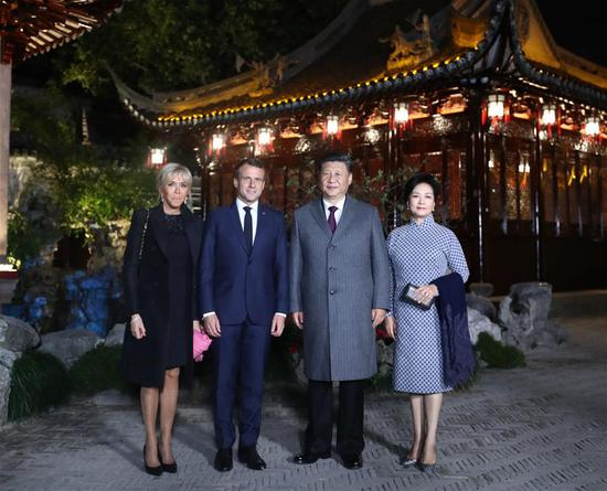 Chinese President Xi Jinping and his wife Peng Liyuan meet with French President Emmanuel Macron and his wife Brigitte Macron at the Yuyuan Garden in Shanghai, east China, Nov. 5, 2019. (Xinhua/Ju Peng)