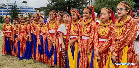 Girls from far western Nepal in traditional attire get ready to perform in celebration of Gaura festival at Tundikhel in Kathmandu, Nepal, Sept. 3, 2018. The Gaura festival is mostly celebrated by people of far western part of Nepal where Goddess Gauri is worshipped for long and healthy life of their husbands. (Xinhua/Sunil Sharma)