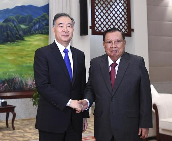 Wang Yang, a member of the Standing Committee of the Political Bureau of the Communist Party of China Central Committee and chairman of the National Committee of the Chinese People's Political Consultative Conference (CPPCC), meets with General Secretary of the Lao People's Revolutionary Party Central Committee and Lao President Bounnhang Vorachit on Nov. 19, 2019. Wang paid an official visit to Laos from Nov. 16 to 19. (Xinhua/Yan Yan)