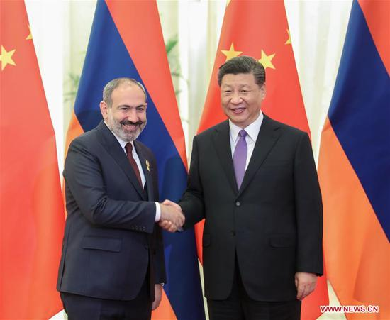 Chinese President Xi Jinping (R) meets with Armenian Prime Minister Nikol Pashinyan, who is in China to attend the Conference on Dialogue of Asian Civilizations (CDAC), at the Great Hall of the People in Beijing, capital of China, May 14, 2019. (Xinhua/Yao Dawei)